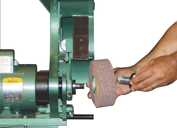 Model 562 accepts nylon, buffing, wire and fiber wheels. Must remove contact wheel guard to run wheels.