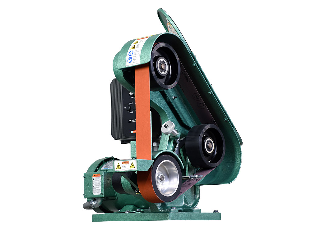 42103 shown with supplied workrest and safety door open. Features urethane idler wheels for long life. Variable speed Model 482 2` x 48` three wheel belt grinder / sander.  1.5 HP/220 volt/three phase.